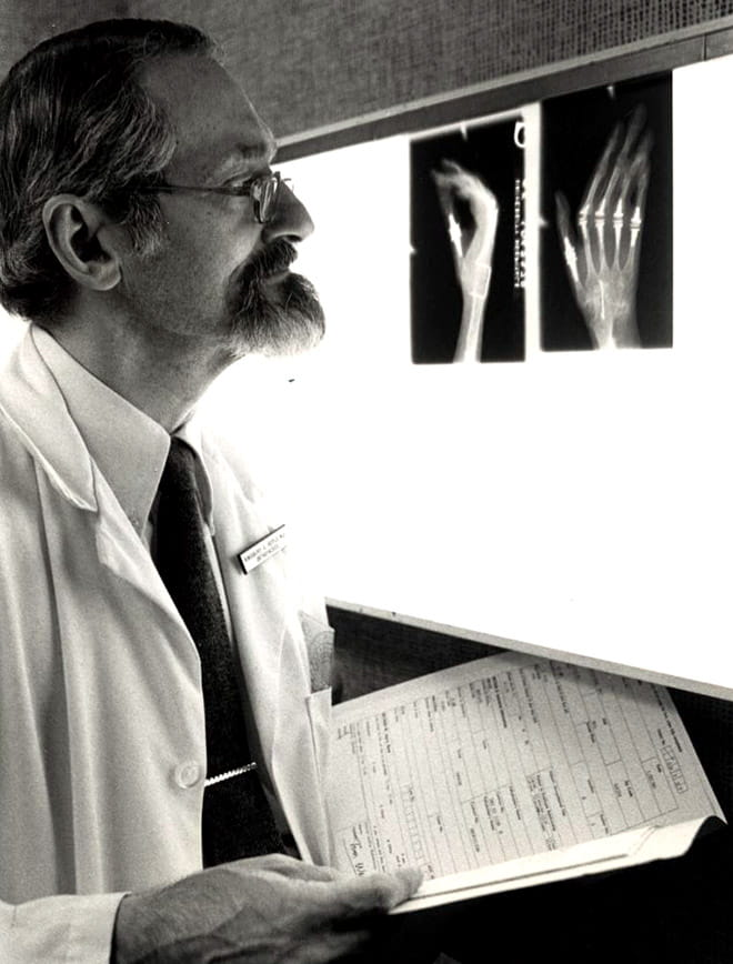 Kingsbury Heiple, MD examines x-rays
