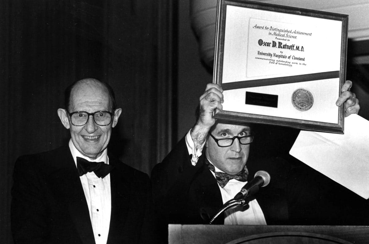 Oscar Ratnoff, MD (right) receiving an award