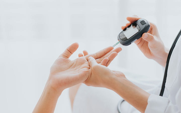 hands testing blood sugar levels