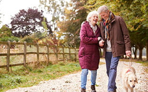 older couple on autumn walk