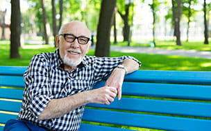 older man on park bench