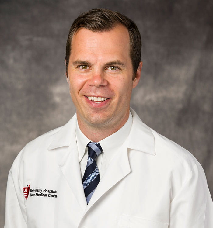 James E. Voos, MD