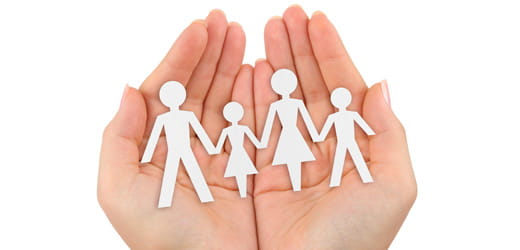 Hands holding people cutouts.