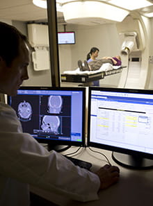 UH Seidman Cancer Center - Services - Proton Therapy - man looking at computer screen